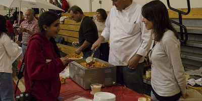 Senior Sam Alavi asks for a large platter of spaghetti from the Italian booth.