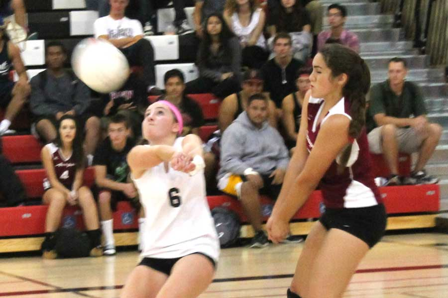 Senior Vienna Auerweck and sophomore Anna Joshi go for a bump in a  game versus Burlingame on Sept. 26.