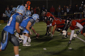 Dons and Knights prepare for the next play.